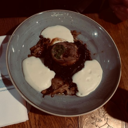 beef bourguignon style with seared foie gras , whipped creamy mash and confit onions